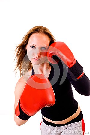 Attractive Caucasian girl practicing boxing
