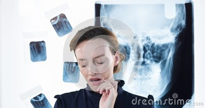 Caucasian woman touching her cheek and suffering of toothache with x ray pictures in the background stock video footage