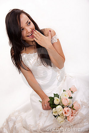 Attractive caucasian woman wearing bridal dress