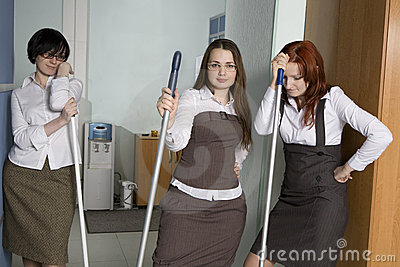 Attractive clerks washing the floor
