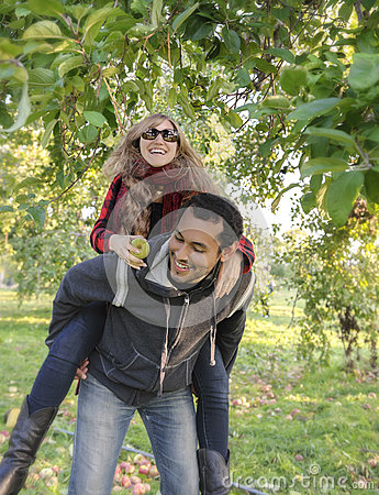 Attractive couple apple picking on a first date