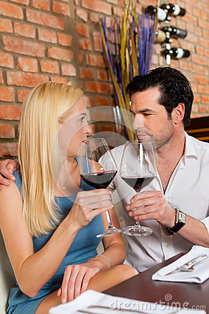 Free Attractive Couple Drinking Red Wine In Restaurant Stock Photos - 26487033
