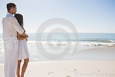 Attractive couple looking out at sea