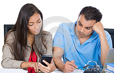 Attractive couple, man and woman, looking distressed from financial problems and mounting bills