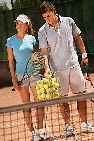 Attractive couple playing tennis