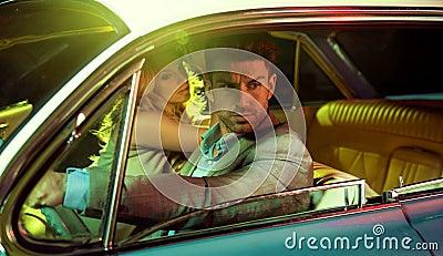 Attractive couple in the retro car