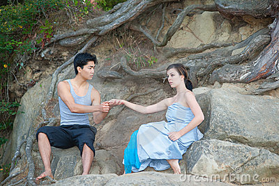 Attractive couple on the rocks