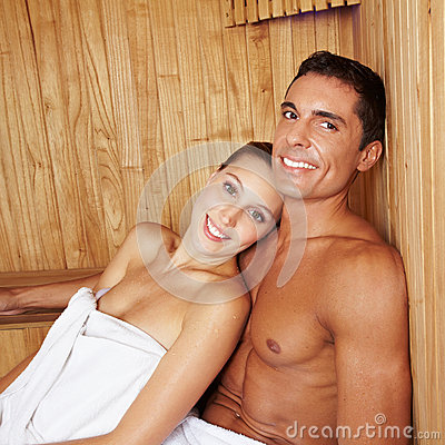 Attractive couple in sauna