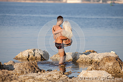 Attractive couple at the sea