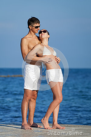 Attractive couple at the sea