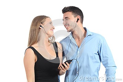 Attractive couple sharing music with a headphones