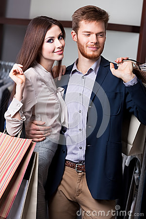 Attractive couple is in the shop