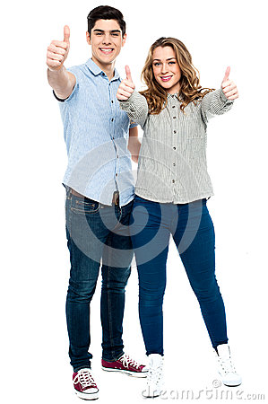Attractive couple showing thumbs up