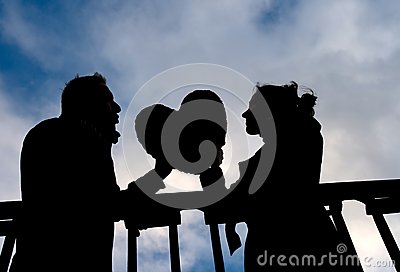 Attractive couple in Silhouette holding a love heart