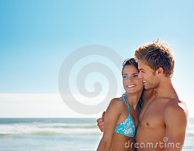 Attractive couple spending time at the beach