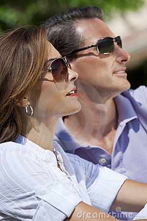 Attractive Couple In Sunshine Wearing Sunglasses