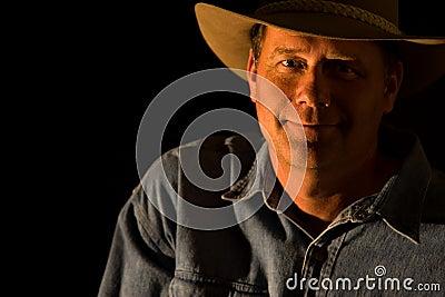 Attractive cowboy black background