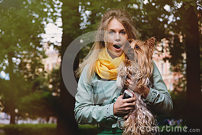 Attractive crazy blonde young woman says wow in surprise looking in camera.
