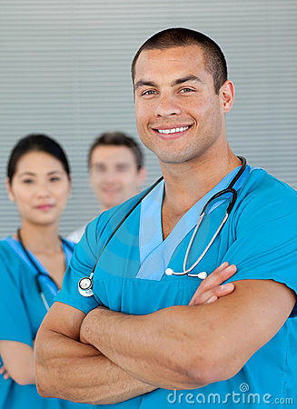 Attractive doctor with his team