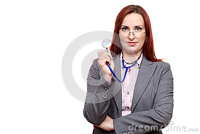 Attractive doctor or physician looking over glasses