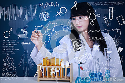 Attractive doctor writing formula on blue