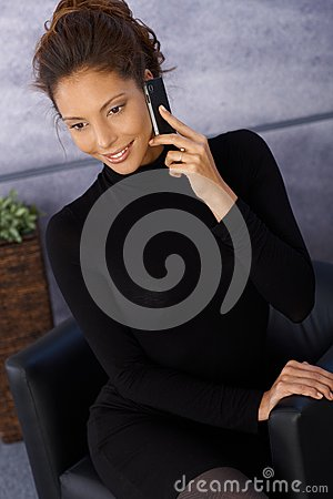 Attractive ethnic businesswoman on mobile