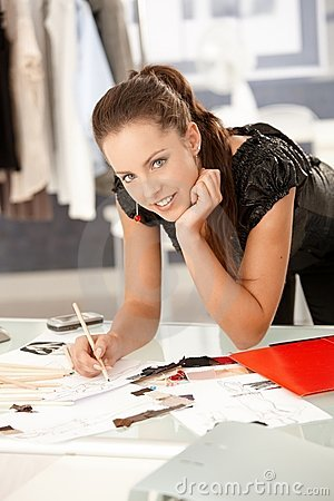 Attractive fashion designer working in office