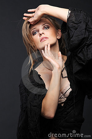 Attractive fashion model on dark background.
