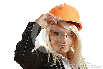 Attractive female architect in hardhat