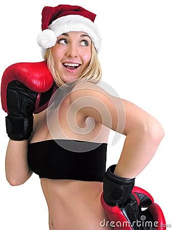 Attractive female boxer in santa style