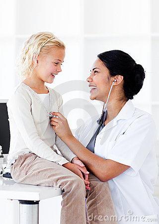 Attractive female doctor with her patient