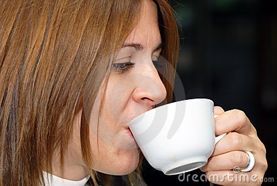 Attractive female enjoying a cup of coffee