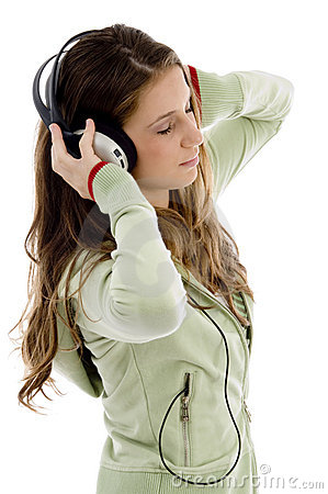 Attractive female enjoying music