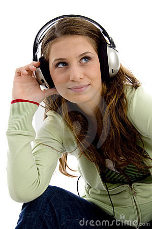 Attractive female enjoying music track