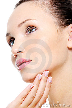 Attractive female face in skincare treatment