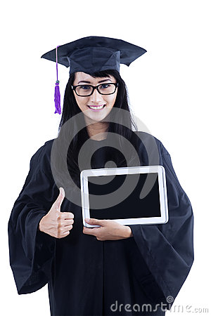 Attractive female graduate hold e-tablet and thumbs up