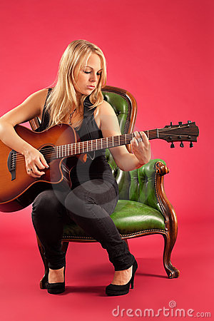 Attractive female guitar player