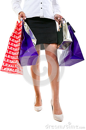 Attractive female in high heels with shopping bags