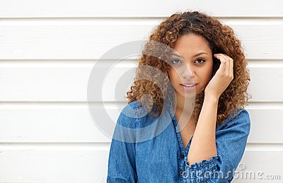 Attractive female looking at camera with hand in hair