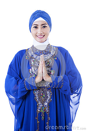 Attractive female muslim in blue dress on white