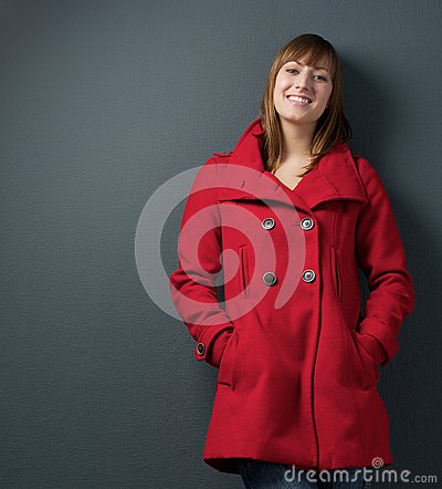Attractive female in red winter jacket