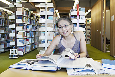 Attractive female student study at library