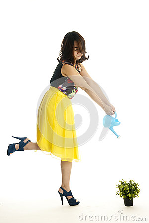 Attractive female with a watering can