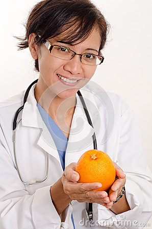 Doctor with an orange