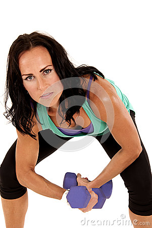 Attractive fit brunette woman holding barbells leaning forward