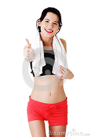 Woman in sport clothes gesturing thumbs up