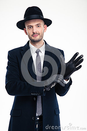Free Attractive Gentleman Putting On Black Leather Gloves Royalty Free Stock Image - 64865846