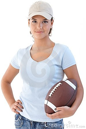 Attractive girl with American football