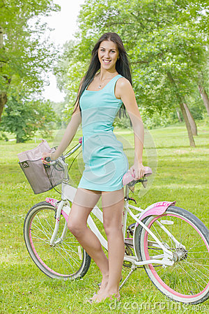 Attractive girl  with bicycle