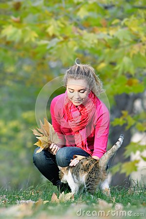 Attractive girl and cat on nature
